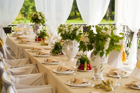 Decorated chair and tables set for wedding