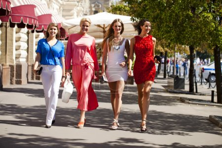 Four shopping women walking at the red square in Moscow