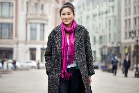 Young beautiful asian woman in stylish gray coat