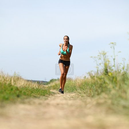 Photo for Happy young Woman Runner. Fitness Girl Running outdoors - Royalty Free Image