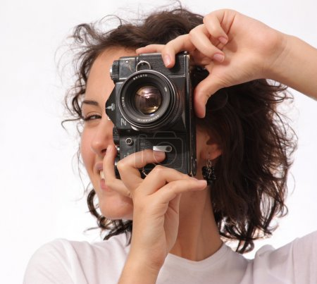 Close up lifestyle portrait of young pretty photographer girl ma