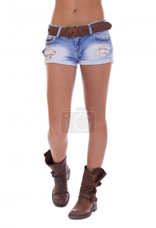 Woman in jeans texas shorts. Young tanned woman wearing blue sho