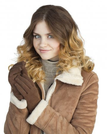 Young beautiful girl in a leather sheepskin coat, ...