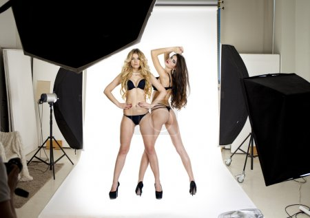 Two professional models posing in the studio Professional model