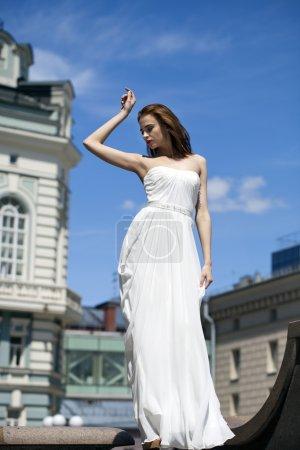 Full length portrait of beautiful model woman with long legs wea
