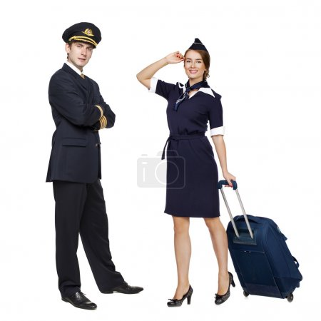 Captain of the aircraft and a beautiful flight attendant in a da