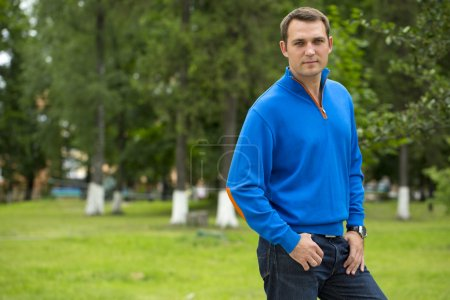 Photo for Close up, Handsome young man in blue sweater in the summer park - Royalty Free Image