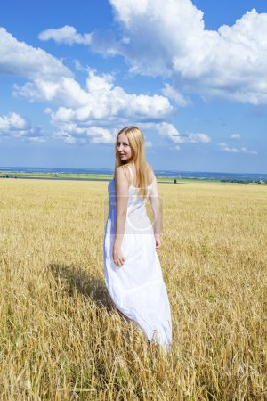 Full-length portrait of a beautiful young girl in a white dress