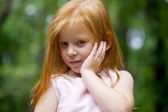 Close up, portrait of little redheaded girl