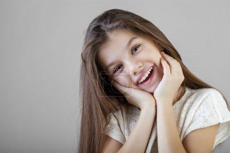 Portrait of a charming brunette little girl