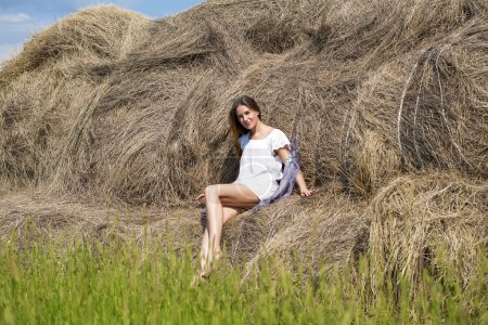 Photo for Young beautiful girl in the hayloft in the village - Royalty Free Image