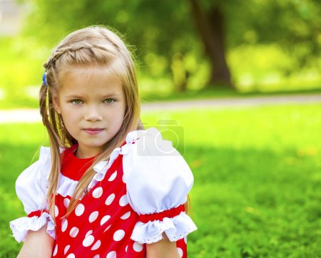 Portrait of a charming little girl looking at camera