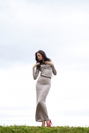 Young woman in sexy long gray dress