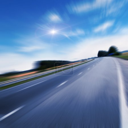Photo for Highway traffic in sunset near fields, view in motion - Royalty Free Image