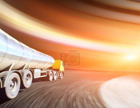 truck on blurry asphalt road