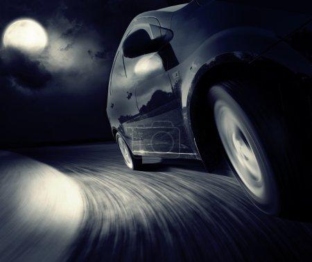 black car in turn