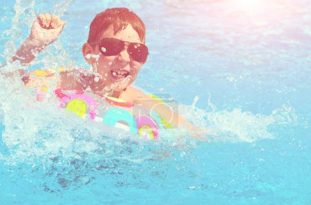 boy swimming pool