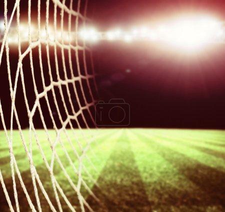Photo pour Les lumières au stade de football et de la nuit - image libre de droit