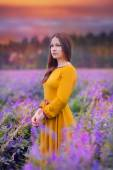 Beautiful young woman in the meadow