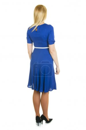 Photo for Pretty blonde woman in elegance blue dress stands  back to the camera isolated on white background - Royalty Free Image