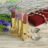 lipsticks with decorative flowers,branch  and  jewels