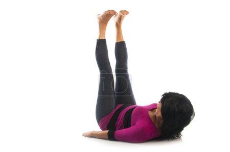 Woman in Urdhva Prasarita Padasana yoga pose