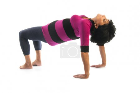 Mature woman in Table  yoga pose