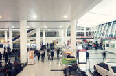Lidé v sále Tbilisi International Airport