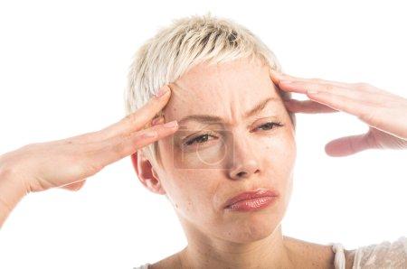 Woman suffering from head ache
