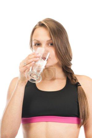 Beautiful girl drinking water
