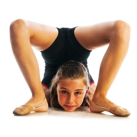 Girl doing gymnastic exercise