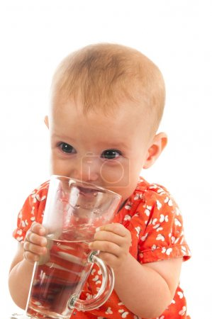 cute baby girl drinking water