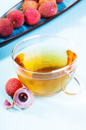 Cup of fruit tea with fresh ripe lychee fruits