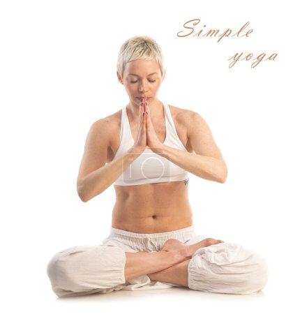 Woman in   Easy yoga pose (Sukhasana)