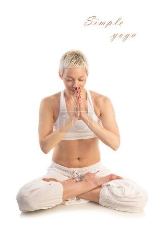 Woman in yoga Lotus pose Padmasana