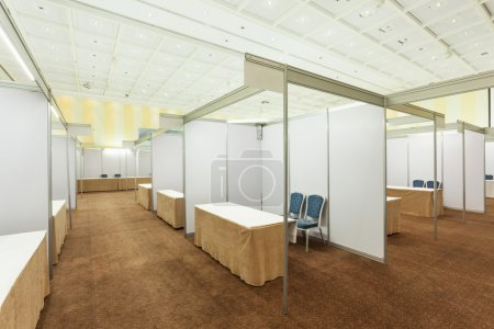 Photo for Trade show interior with booth and tables - Royalty Free Image