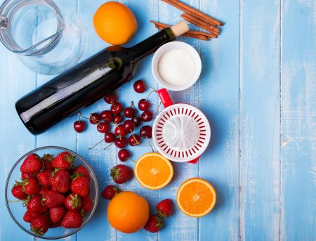 Ingredients for sangria on the wooden table, top view