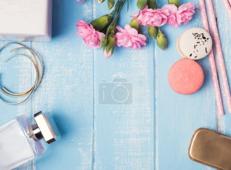 Cute feminine objects on blue colored table