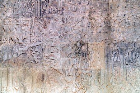 Photo pour Sculpture khmère secours des dieux, lutte contre les démons. Paroi interne de la temple de Angkor Wat, Siem Reap, Cambodge. - image libre de droit