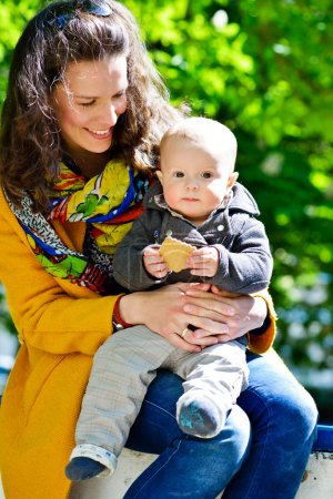 Photo for Mother and baby son outdoors in spring time - Royalty Free Image