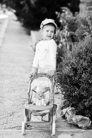girl walking with  stroller
