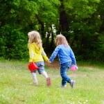 Two friends girls walking hand in hand...
