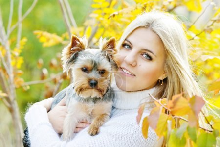 Teen girl with little dog