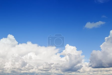 Photo for Blue sky with fluffy white clouds background. - Royalty Free Image