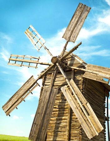 Wooden windmill over sky