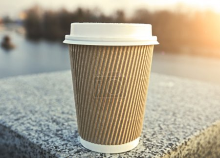 Photo for One coffee cup over city background - Royalty Free Image