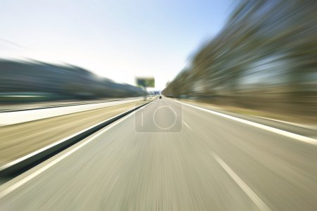 Photo for Driving at high speed in empty road - motion blur - Royalty Free Image