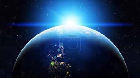 Photo pour Notre terre dans le cosmos et une lumière vive - image libre de droit