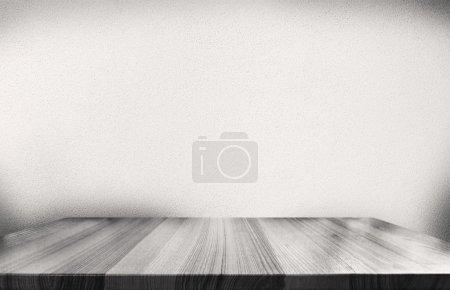 Foto de Pared de cemento gris y vacío escritorio de madera, colores blanco y negro - Imagen libre de derechos
