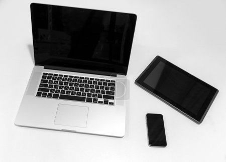 View of tablet, phone and laptop